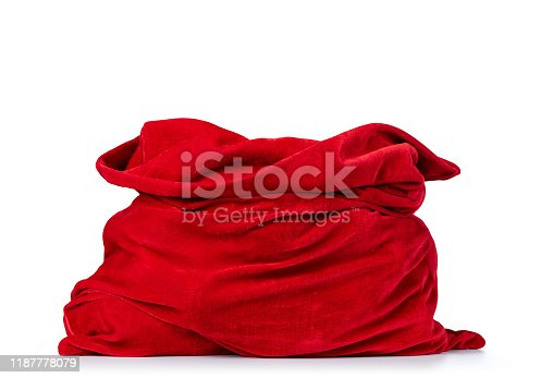istock Santa Claus open red bag full, isolated on white background. File contains a path to isolation. 1187778079