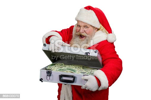 istock Santa Claus opening suitcase with money. 868433070