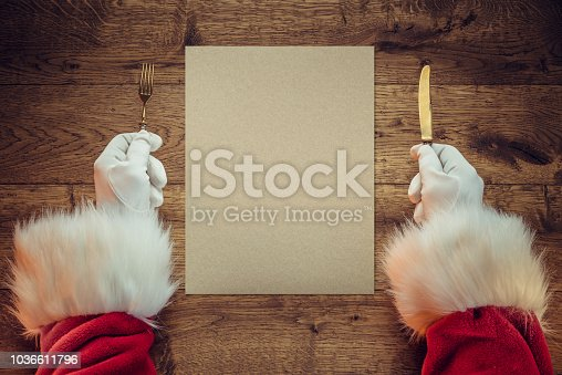 Santa Claus holding fork and knife