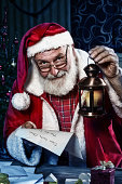 Traditional Santa Claus reading a letter from children.