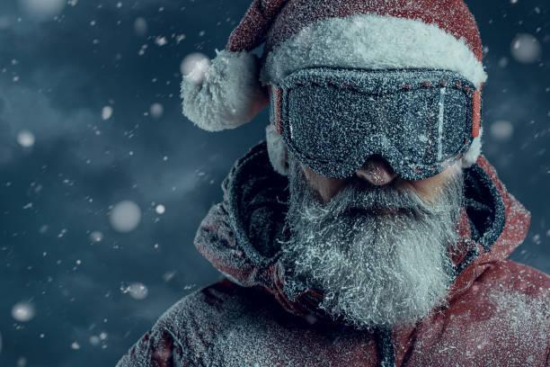 Santa Claus Santa Claus under heavy blizzard ski goggles stock pictures, royalty-free photos & images