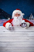 istock Santa Claus pointing in blank sign 531481554