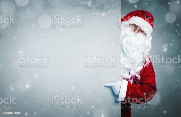 Santa claus pointing on blank banner picture id1060892692?b=1&k=6&m=1060892692&s=612x612&h=fi70pvi2uxeysa2oi rwx 0qsh yjymt 3ywjqxyrbw=