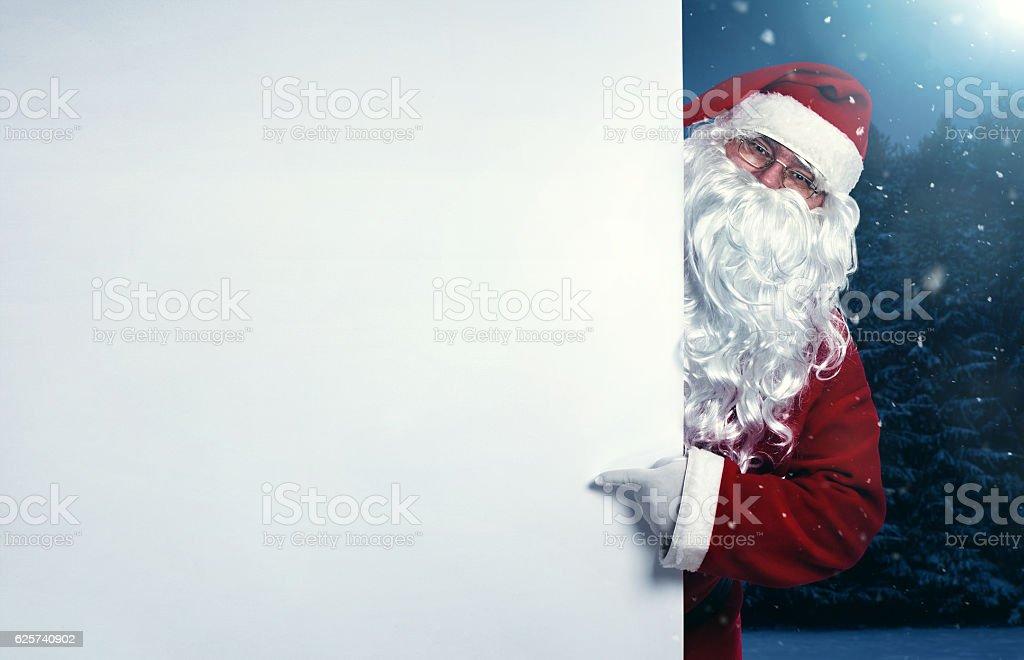 Fotografía De Santa Claus Señalando En Banner En Blanco