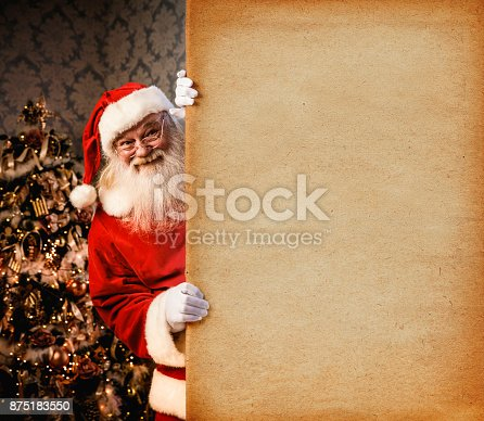 istock Santa Claus pointing on blank banner 875183550