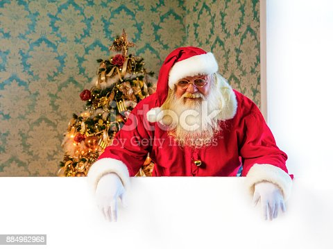 istock Santa Claus pointing on blank banner 884962968