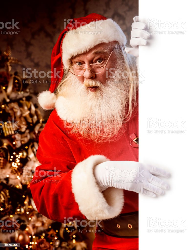 Santa Claus pointing on blank banner - foto stock