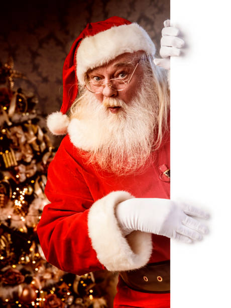 Santa Claus pointing on blank banner stock photo
