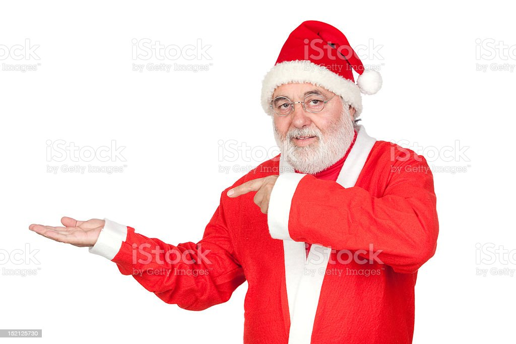 Santa Claus pointing to the outstretched palm of your hand stock photo