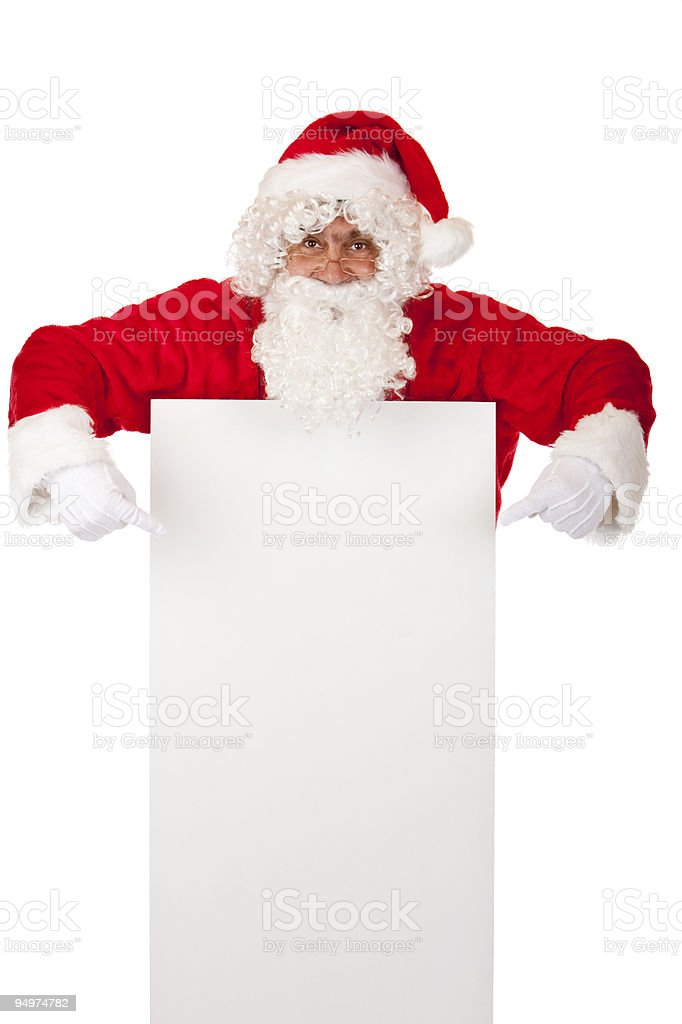 Santa Claus points with fingers on special Christmas advertisment sign royalty-free stock photo