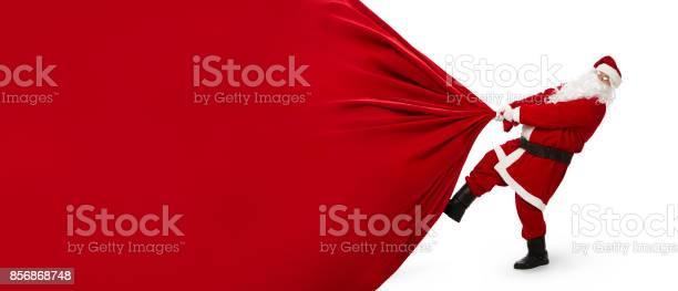 Santa claus pulling huge bag of gifts picture id856868748?b=1&k=6&m=856868748&s=612x612&h=vdo0ehvhhzjvbwd7gdoc1iho01aqj3tpbw1adp4ftq8=