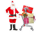 Santa Claus pushing a cart full of gifts