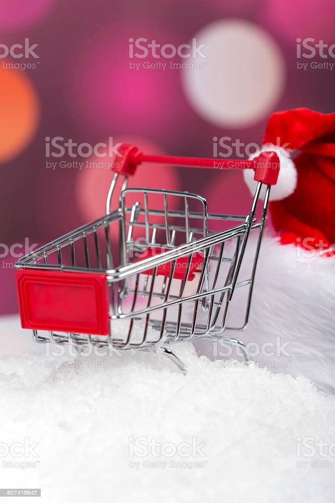 Santa Claus pushing a shopping cart full of gifts stock photo