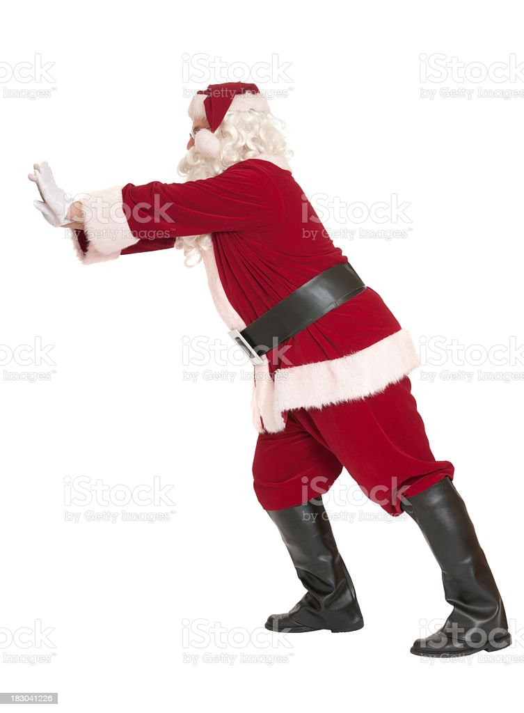 Santa Claus Pushing, on White Background royalty-free stock photo