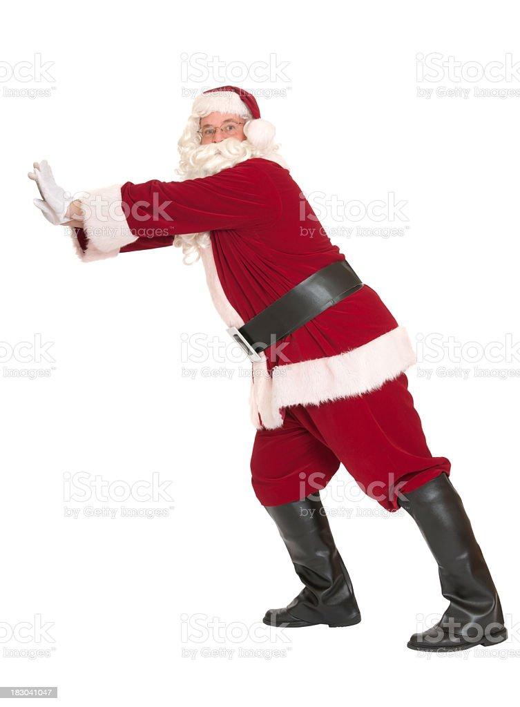 Santa Claus Pushing While Looking At The Camera royalty-free stock photo