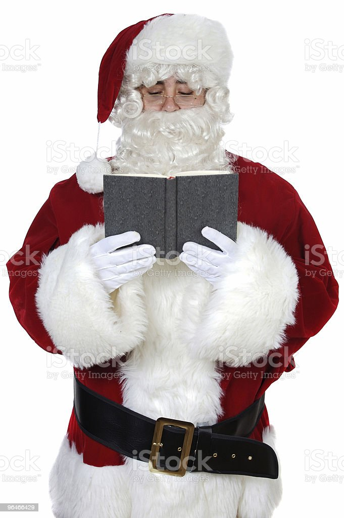 Santa Claus reading a book royalty-free stock photo
