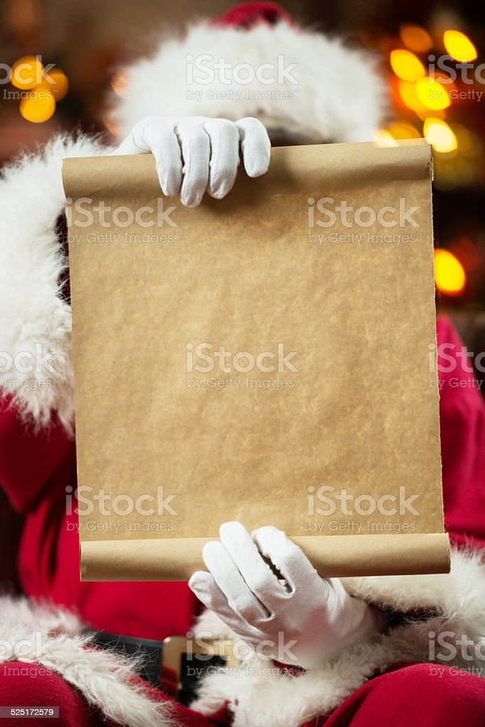 Santa Claus reading a list. stock photo