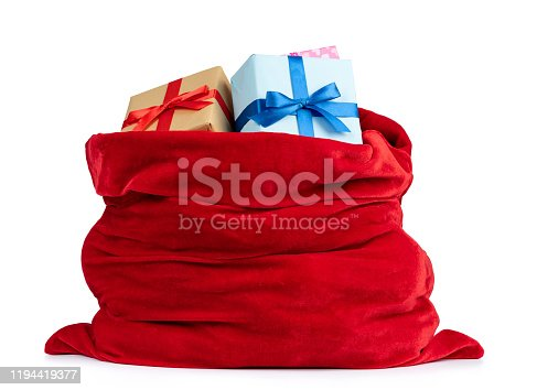 istock Santa Claus red bag full of Christmas boxes with gifts, isolated on white background. File contains a path to isolation 1194419377