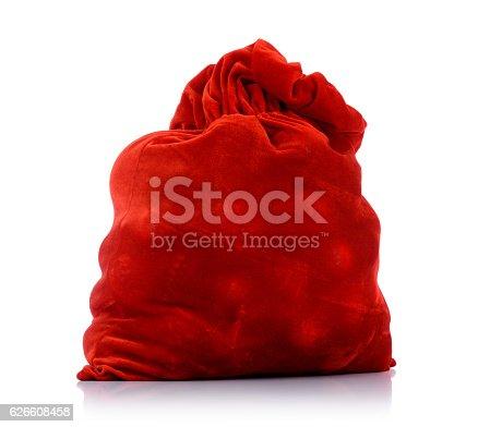 istock Santa Claus red bag full, on white background. 626608458