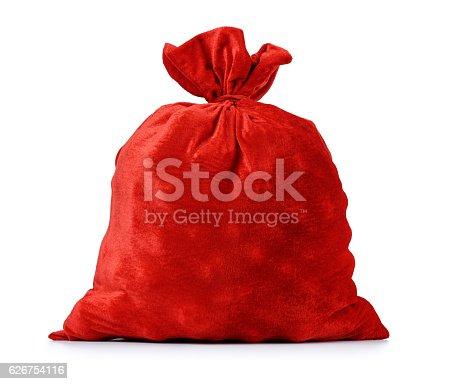 istock Santa Claus red bag full, on white background. 626754116