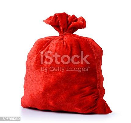 istock Santa Claus red bag full, on white background. 626755050