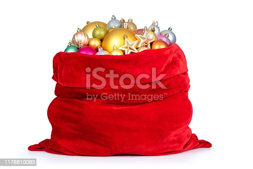 istock Santa Claus red bag with Christmas toys on white background. File contains a path to isolation. 1176810083