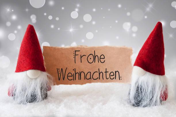 santa claus, red hat, frohe weihnachten means merry christmas, gray background - weihnachten zdjęcia i obrazy z banku zdjęć