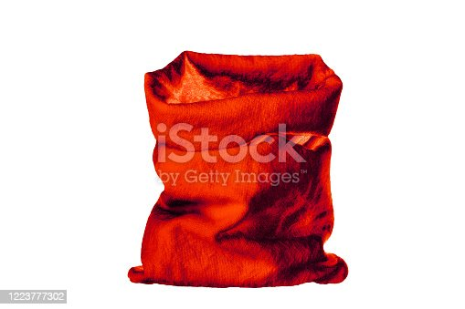 istock Santa Claus red sack of presents on white background isolated close up, Santa's bag full of Сhristmas gifts, bagful filled with New Year presents, xmas holiday traditional attribute design, copy space 1223777302