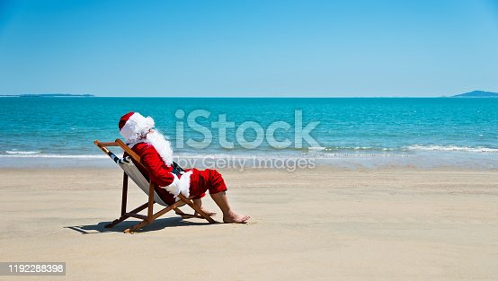 Santa claus relaxing on the beach.
