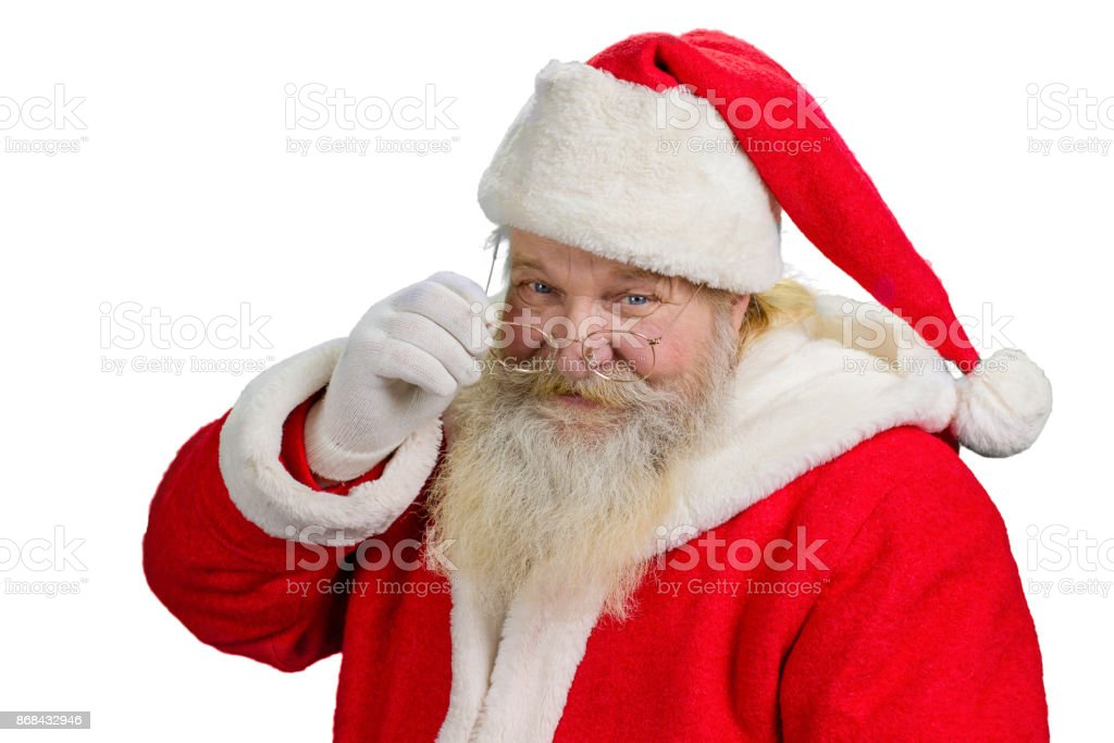 Santa Claus removing his glasses. - foto stock
