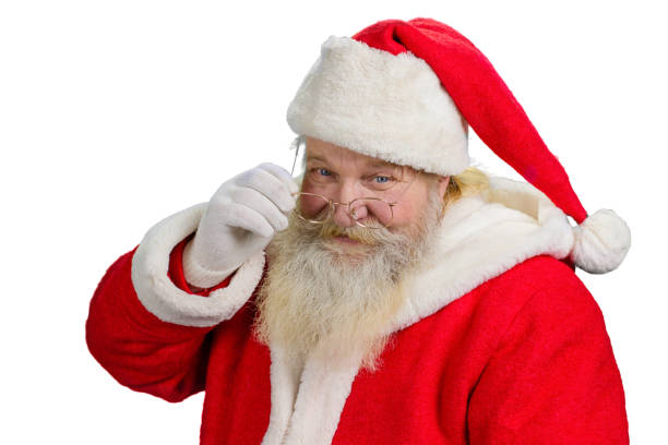Santa Claus removing his glasses. stock photo