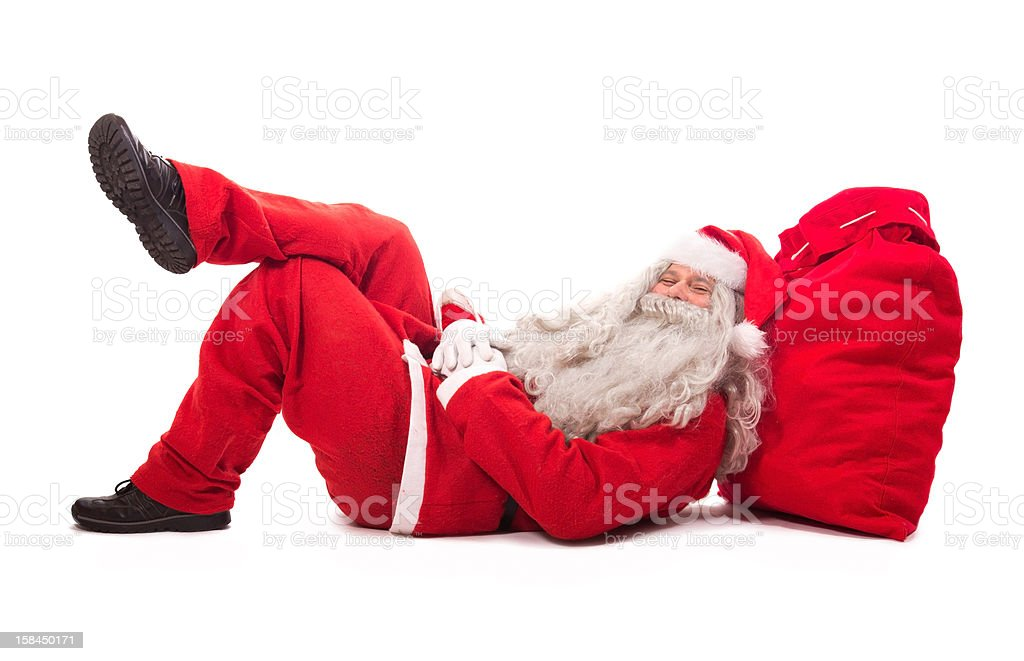Santa Claus resting against his red sack stock photo
