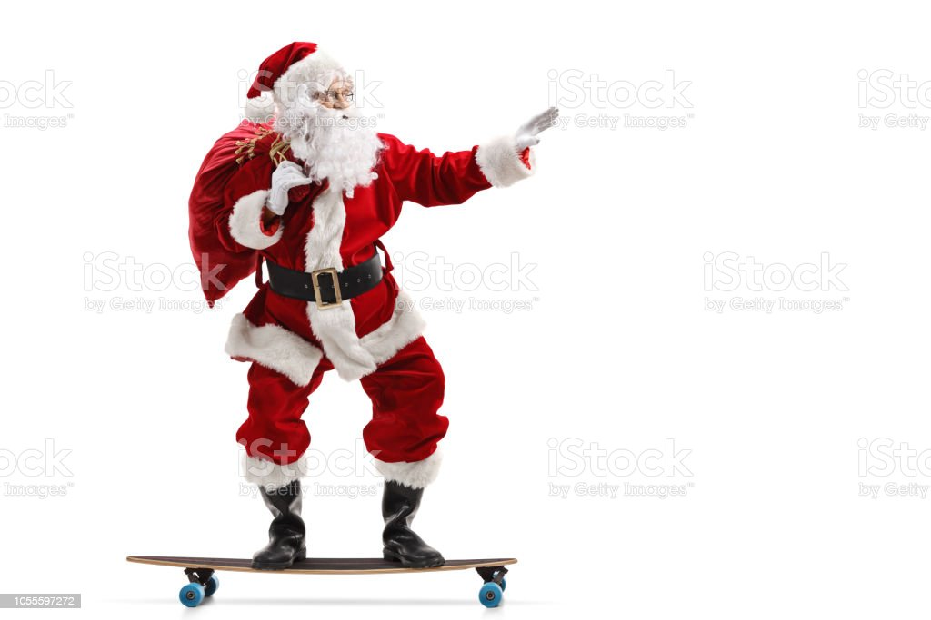 Santa Claus riding a longboard isolated stock photo