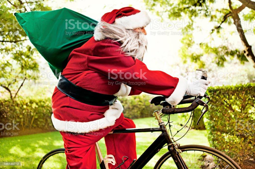 Santa Claus riding bike royalty-free stock photo