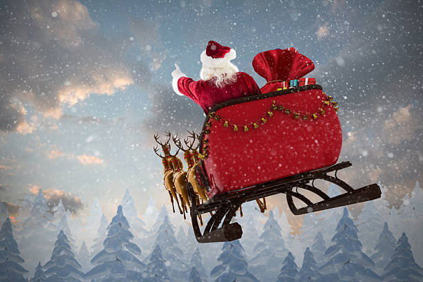 Santa Claus riding on sled with gift box Santa Claus riding on sled with gift box against snow falling on fir tree forest sled stock pictures, royalty-free photos & images