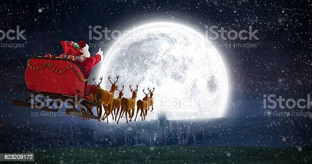 Santa claus riding on sleigh against bright moon picture id623209172?b=1&k=6&m=623209172&s=612x612&h=xgyekagbd8oyilwgdau5t9bthfvjchhpzlvrfoae7ky=