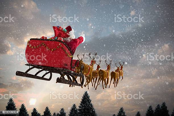 Santa claus riding on sleigh with gift box picture id623209324?b=1&k=6&m=623209324&s=612x612&h=dy6s3oobdlvpqxvj6xjg5vgtqegklwvmckptpib6mds=
