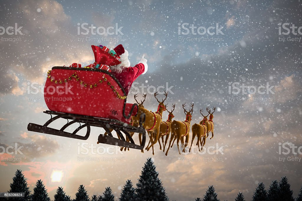 Santa Claus riding on sleigh with gift box stock photo