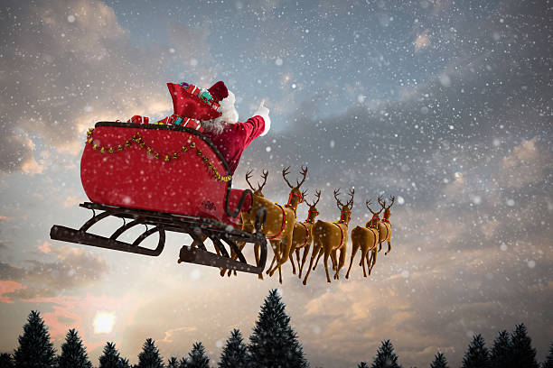 santa claus riding on sleigh with gift box - rentier stock-fotos und bilder