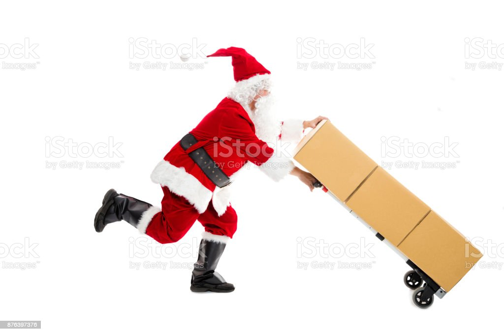 Santa Claus running and delivering Christmas presents Santa Claus running and delivering Christmas presents Adult Stock Photo