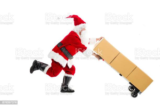 Santa Claus Running And Delivering Christmas Presents Stock Photo - Download Image Now