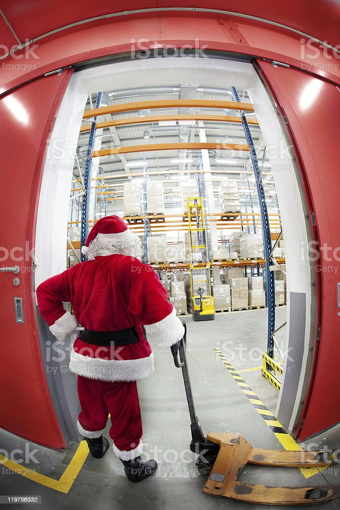 Santa Claus searching for gifts stock photo