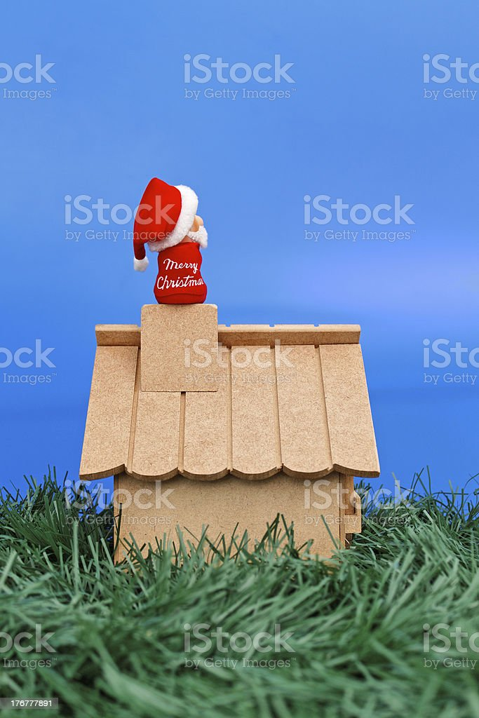 Santa Claus seating on a chimney looking at the sky royalty-free stock photo