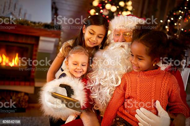 Santa claus sharing smart phone with children picture id626540158?b=1&k=6&m=626540158&s=612x612&h=ttfmnpiom0svjcgv5yul17u1nocceunes1cojg5hclw=