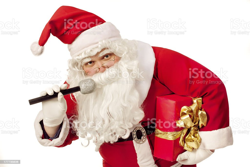 Santa Claus singing  and holding gift royalty-free stock photo
