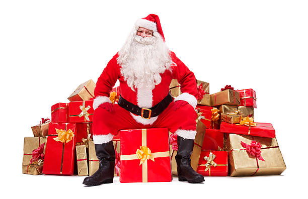 Santa Claus Sitting In Front A Pile Of Christmas Gifts Stock Photo