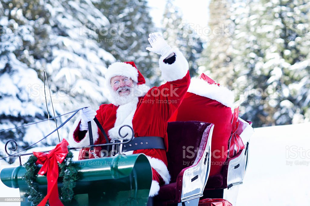 Santa Claus Sitting in His Sleigh Waving stock photo