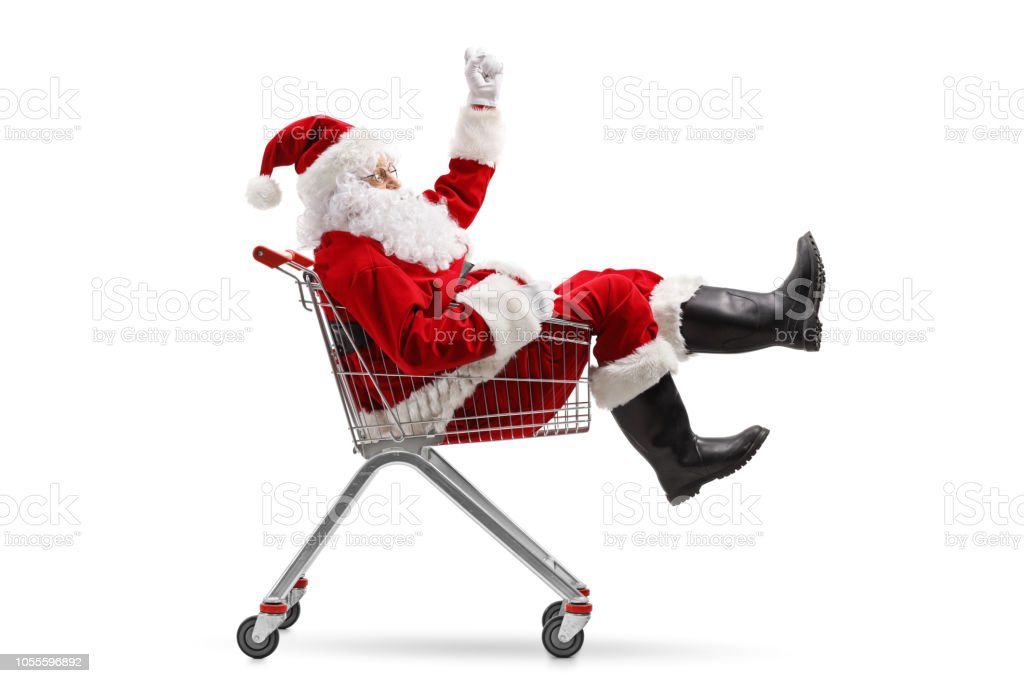 Santa Claus sitting inside a shopping cart stock photo