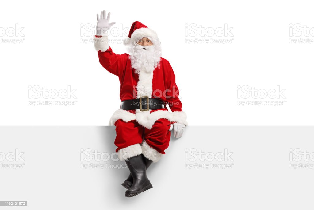 Weihnachtsmann sitzt auf einer Tafel und winkt - Lizenzfrei Alter Erwachsener Stock-Foto