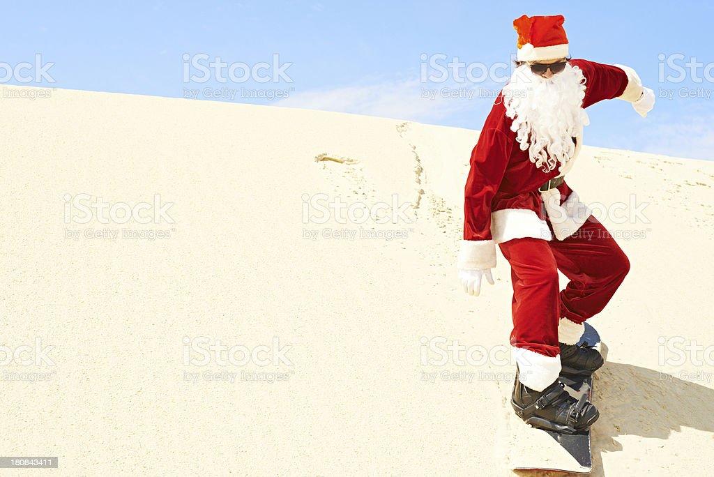 Santa Claus snowboarding royalty-free stock photo